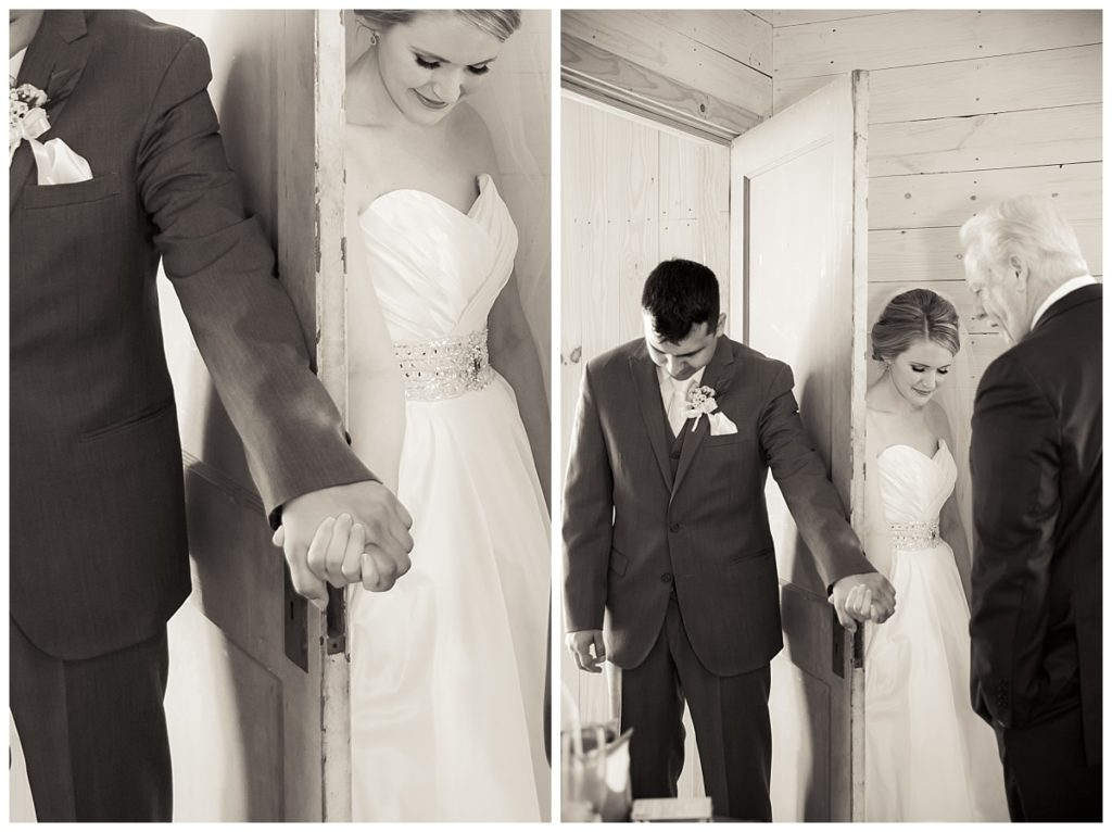 Bride and groom pray in the doorway