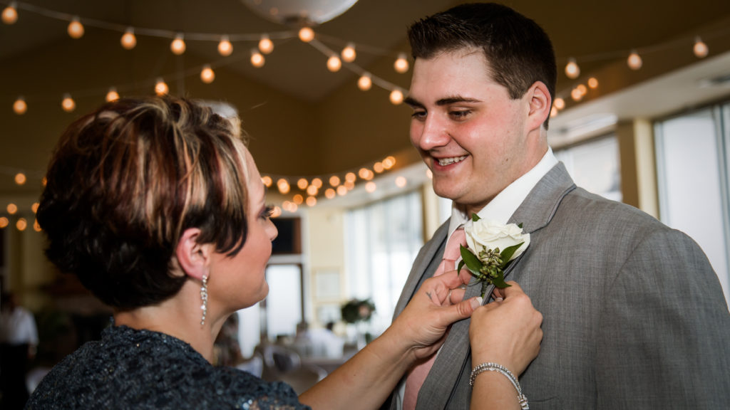 Jen & Chuck Photography | Mom Pinning the Boutonniere